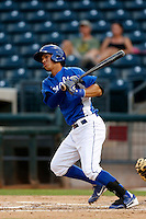 Cesar Gonzalez #45 of the AZL Royals bats against the AZL Rangers at Surprise Stadium on July 15, 2013 in Surprise, Arizona. AZL Rangers defeated the AZL Royals, 3-2. (Larry Goren/Four Seam Images)