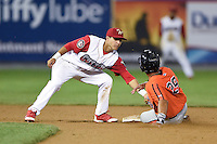 Williamsport Crosscutters shortstop Emmanuel Marrero (18) tags Hector Veloz (29) sliding in during a game against the Aberdeen IronBirds on August 4, 2014 at Bowman Field in Williamsport, Pennsylvania.  Aberdeen defeated Williamsport 6-3.  (Mike Janes/Four Seam Images)