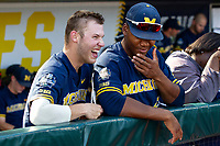 Michigan Wolverines outfielder Dominic Clementi (13) laughs with teammate Jordan Nwogu (42) before Game 3 of the NCAA College World Series Finals on June 26, 2019 at TD Ameritrade Park in Omaha, Nebraska. Vanderbilt defeated Michigan 8-2 to win the National Championship. (Andrew Woolley/Four Seam Images)