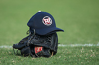 A pair of High Point-Thomasville HiToms hats sit on top of two gloves prior to the Coastal Plain League game against the Asheboro Copperheads at Finch Field on June 12, 2015 in Thomasville, North Carolina.  The HiToms defeated the Copperheads 12-3. (Brian Westerholt/Four Seam Images)