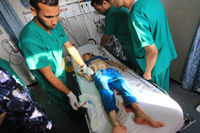 Palestinian medics display the bodies of three children from the Shuheiber family  who were killed in an airstrike in Gaza City's Sabra district, and four-year-old Yassin al-Humidi, who died from injuries sustained in an earlier airstike, in the morgue at al-Shifa hospital, in Gaza City, on July 17, 2014. Israeli air strikes in Gaza killed five children, medics said, hours after a temporary humanitarian ceasefire ended.  Photo by Mohammed Asad
