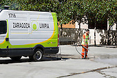 A street cleaner employed by the City Council washes down a square in the centre of Zaragoza, Aragon, Spain.