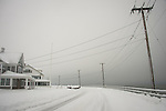Middle Beach Road in winter with fresh snow. Long Island Sound.