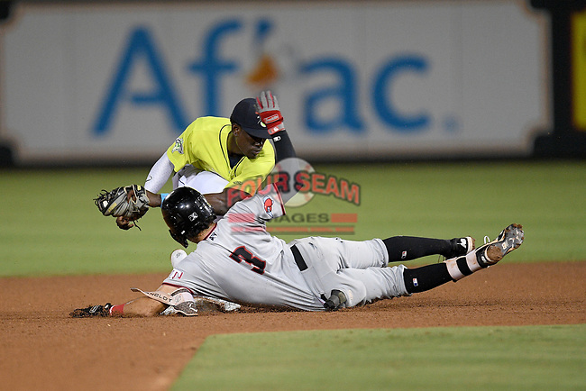 Shortstop Ronny Mauricio (2) of the Columbia Fireflies makes the putout tag on Jonathan Ornelas (3) of the Hickory Crawdads, who was attempting to steal, in a game on Wednesday, August 28, 2019, at Segra Park in Columbia, South Carolina. Hickory won, 7-0. (Tom Priddy/Four Seam Images)