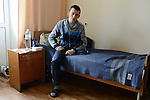 """Refat, 19, a Ukrainian soldier from Crimea, sits on his hospital bed at the Main Military Clinical Hospital of the Ministry of Internal Affairs in Kiev, Ukraine on April 8, 2014.  Refat was shot in the left knee by a sniper on February 20, 2014 while trying to maintain a line of soldiers on orders and had the lower part of his left leg amputated from above the knee.<br /> <br /> """"We had orders to stand in the line.  In the morning, it was quite calm and silent and then the protesters started to attack and they threw a grenade and I walked away from there and then I felt a sniper's bullet in my knee.  It was the morning of February 20 and we were unarmed.  I was standing with just a shield.  That morning there was shooting from both sides.  The criminal case is still open and nobody knows why they were shooting.  I blame the president.  I want a normal president and stability to come to Ukraine.  I want to stay in Kiev and enter the main university and study law.  I want to become a prosecutor.  I want things to be tranquil here in Ukraine."""""""