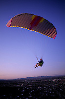 Para gliding off mountain at sunset in Tuscon Arizona USA