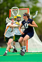 1 May 2010: University of Vermont Catamount midfielder Natalie Jones, a Sophomore from Saratoga Springs, NY, defends against University of New Hampshire Wildcat attacker Jenny Simpson, a Freshman from New Canaan, CT, at Moulton Winder Field in Burlington, Vermont. The Lady Catamounts fell to the visiting Wildcats 18-10 in the last game of the 2010 regular season. Mandatory Photo Credit: Ed Wolfstein Photo