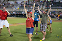 Two fans celebrate after winning a balloon popping contest between innings of the South Atlantic League game between the West Virginia Power and the Kannapolis Intimidators at Kannapolis Intimidators Stadium on June 17, 2017 in Kannapolis, North Carolina.  The Power defeated the Intimidators 6-1.  (Brian Westerholt/Four Seam Images)