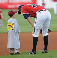 12 April 2008: Greg Creek of the Mississippi Braves, Class AA affiliate of the Atlanta Braves, talks to a youg fan prior to a game against the Mobile BayBears at Trustmark Park in Pearl, Miss. Photo by:  Tom Priddy/Four Seam Images