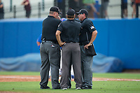 The umpiring crew gets together to discuss a call during the game between the Wake Forest Demon Deacons and the Florida Gators in Game Three of the Gainesville Super Regional of the 2017 College World Series at Alfred McKethan Stadium at Perry Field on June 12, 2017 in Gainesville, Florida. The Gators defeated the Demon Deacons 3-0 to advance to the College World Series in Omaha, Nebraska. (Brian Westerholt/Four Seam Images)