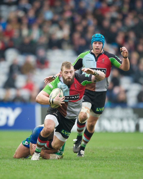 Joe Marler of Harlequins is tackled during the Heineken Cup match between Harlequins and Connacht Rugby at The Twickenham Stoop on Saturday 12th January 2013 (Photo by Rob Munro).