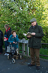 White Bread Meadow annual auction, Bourne Lincolnshire UK. At the Queen's Bridge, Eastgate, Stephen Knipe auctioneer and land agent reads out the rules of the auction as stipulated by Mathew Clay in his Will of 1742.