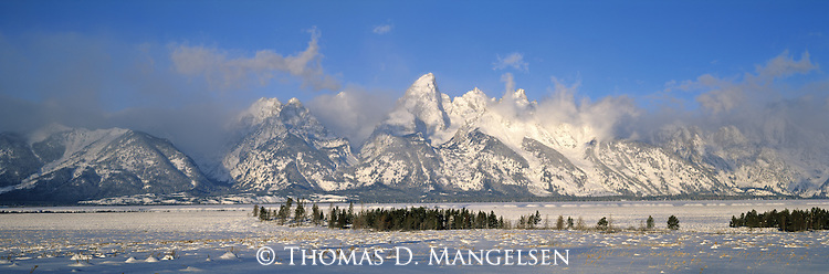 Clouds partly shroud the Tetons on a winter morning in Grand Teton National Park, Wyoming.