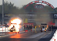 Sep 3, 2017; Clermont, IN, USA; NHRA top fuel driver Tony Schumacher (left) explodes an engine on fire alongside Clay Millican during qualifying for the US Nationals at Lucas Oil Raceway. Mandatory Credit: Mark J. Rebilas-USA TODAY Sports