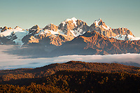 Sunset over Mt. Cook 3754m right and Mt. Tasman 3497m left seen from Okarito Lookout, Westland Tai Poutini National Park, UNESCO World Heritage Area, West Coast, New Zealand, NZ