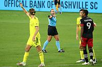 NASHVILLE, TN - SEPTEMBER 23: Referee Tori Penso yells at Walker Zimmerman #25 of Nashville SC during a game between D.C. United and Nashville SC at Nissan Stadium on September 23, 2020 in Nashville, Tennessee.