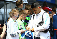 Sergio Aguero of Manchester City signs autographs for fans during the Barclays Premier League match between Swansea City and Manchester City played at The Liberty Stadium, Swansea on 15th May 2016