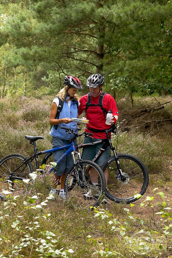 couple riding trek and kona mountain bikes..Chobham Common , Surrey , August 2004..pic copyright Steve Behr / Stockfile