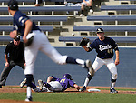 University of Washington's Austin Rei dives back safely as UC Davis' Spencer Henderson takes the pick-off throw from Spencer Koopmans in a college baseball game in Davis, Ca., on Saturday, Feb. 16, 2013. Davis won the opener 6-5 and dropped the second game 3-2..Photo by Cathleen Allison