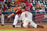 Houston Astros third baseman Scott Dominguez #30 tags out Phillies baserunner Ryan Howard #6 during the Major League baseball game against the Philadelphia Phillies on September 16th, 2012 at Minute Maid Park in Houston, Texas. The Astros defeated the Phillies 7-6. (Andrew Woolley/Four Seam Images).