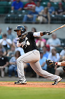 San Antonio Missions outfielder Yeison Asencio (14) hits a double during a game against the Arkansas Travelers on May 24, 2014 at Dickey-Stephens Park in Little Rock, Arkansas.  Arkansas defeated San Antonio 4-2.  (Mike Janes/Four Seam Images)