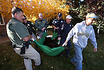 Carson City Sheriff's deputies help state wildlife officials load an adult male bear caught in a downtown backyard in Carson City, Nev., on Tuesday, Oct. 22, 2013. The bear was processed, tagged and later released in the mountains west of Carson City.<br /> Photo by Cathleen Allison