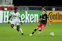 WASHINGTON, DC - SEPTEMBER 27: Griffin Yow #22 of D.C. United battles for the ball with De Juan Jones #24 of New England Revolution during a game between New England Revolution and D.C. United at Audi Field on September 27, 2020 in Washington, DC.