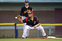Batavia Muckdogs first baseman Eric Gutierrez (43) stretches for a throw during a game against the West Virginia Black Bears on August 20, 2016 at Dwyer Stadium in Batavia, New York.  Batavia defeated West Virginia 7-2. (Mike Janes/Four Seam Images)