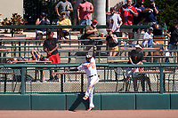Baltimore Orioles outfielder Yusniel Diaz (23) attempts to catch a home run hit by Gregory Polanco (not shown) during a Major League Spring Training game against the Pittsburgh Pirates on February 28, 2021 at Ed Smith Stadium in Sarasota, Florida.  (Mike Janes/Four Seam Images)