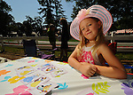 28 August 10: Alexandria Brown, from Orlando, Florida plays a Princess Old Maid on Travers Day at Saratoga Race Course in  Saratoga Springs, New York.