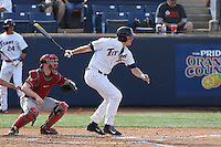 Tanner Pinkston #35 of the Cal State Fullerton Titans bats in front of Washington State Cougars catcher Collin Slaybaugh #28 during a game at Goodwin Field on  February 15, 2014 in Fullerton, California. Washington State defeated Fullerton, 9-7. (Larry Goren/Four Seam Images)