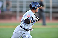 Pulaski Yankees shortstop Jesus Bastidas (12) runs to first base during a game against the Elizabethton Twins at Joe O'Brien Field on June 27, 2016 in Elizabethton, Tennessee. The Yankees defeated the Twins 6-4. (Tony Farlow/Four Seam Images)