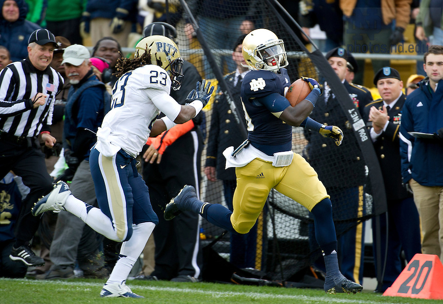 Nov. 3, 2012; Running back Cierre Wood gains yardage before being pushed out of bounds by Pittsburgh defensive back Lafayette Pitts during the first quarter. Photo by Barbara Johnston/University of Notre Dame