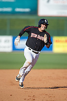 Brett Austin (20) of the Kannapolis Intimidators hustles towards third base against the West Virginia Power at CMC-Northeast Stadium on April 21, 2015 in Kannapolis, North Carolina.  The Power defeated the Intimidators 5-3 in game one of a double-header.  (Brian Westerholt/Four Seam Images)