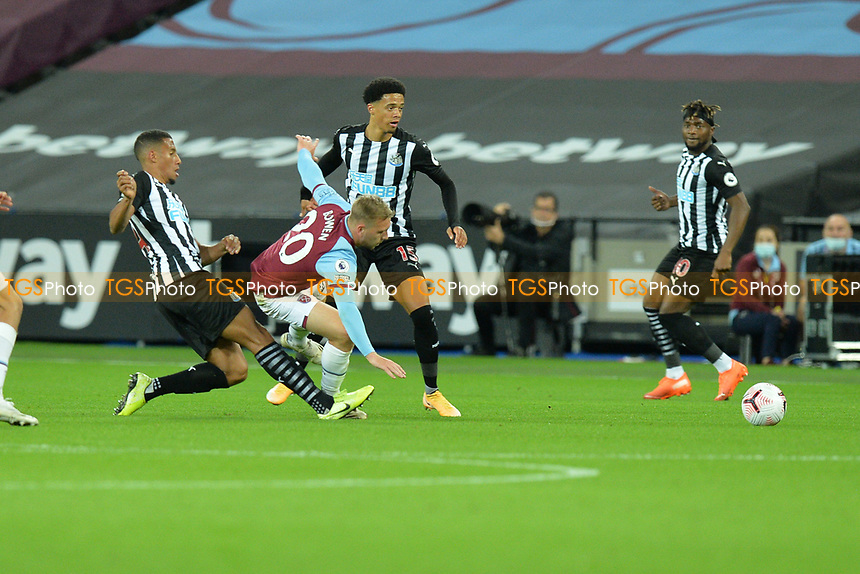Isaac Hayden of Newcastle United tackles Jarrod Bowen of West Ham United during West Ham United during West Ham United vs Newcastle United, Premier League Football at The London Stadium on 12th September 2020