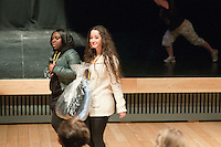 """Fashion students from Kingston College arriving carrying the clothes they'd designed for athletes in the SOGB team.  Special Olympics Surrey put on a show,   """"Beyond the Stars"""", at the Rose Theatre, Kingston upon Thames to raise money for the  SOGB team.  The Special Olympics are for athletes with learning disabilities."""