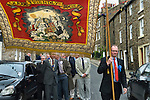 Askrigg Equitable Benevolent and Friendly Society. Askrigg north Yorkshire UK. The annual walk to church behind the Friendly Society banner, starts from outside the Kings Arms Hotel. Honorary members wear white rosettes while ordinary members wear blue.