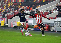9th January 2021; Brentford Community Stadium, London, England; English FA Cup Football, Brentford FC versus Middlesbrough; Djed Spence of Middlesbrough challenges Marcus Forss of Brentford