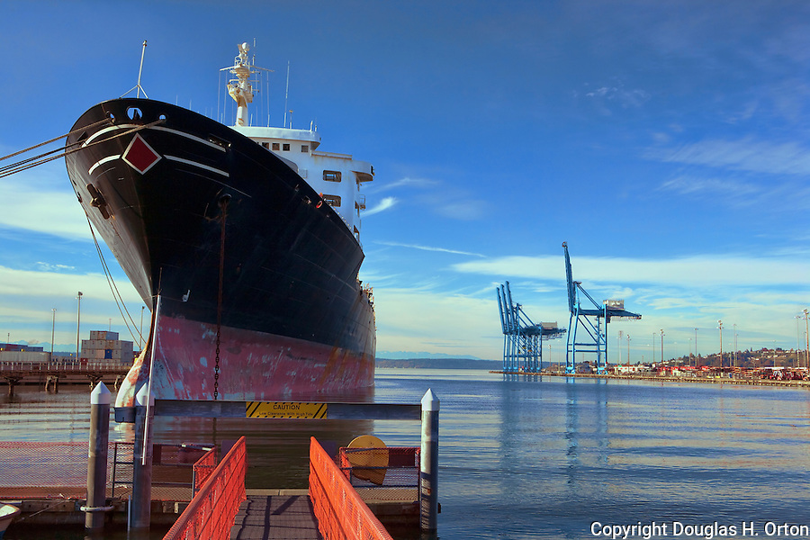 This image represented exclusively by Spaces Images, www.spacesimages.com.  ID: DO_20101104_Container_Commerce_3216.jpg  Thank You. A Horizon Lines ship lies at berth in the Port of Tacoma.  Commencement Bay's history of industry and shipping has led it to designation as a Superfund Cleanup Site and one of the most polluted waterways in the nation.  Commencement Bay Nearshore/Tideflats (CB/NT) Superfund Site.