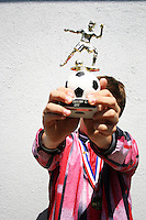 Young footballer shows his winners trophy