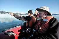 From left, John DeLapp, David Janka and Joe Flynn discuss the scenery as they travel across Heather Bay in the M/V Auklet's red Zodiac in Prince William Sound, Southcentral Alaska on a sunny spring evening in early May.MR/PR