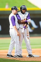 Courtney Hawkins (10) of the Winston-Salem Dash is congratulated by manager Ryan Newman (5) after hitting a triple against the Myrtle Beach Pelicans at BB&T Ballpark on July 7, 2013 in Winston-Salem, North Carolina.  The Pelicans defeated the Dash 6-5 in 8 innings in game two of a double-header.  (Brian Westerholt/Four Seam Images)