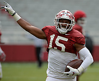 Arkansas defensive back Simeon Blair (15) celebrates an interception Saturday, April 3, 2021, during a scrimmage at Razorback Stadium in Fayetteville. Visit nwaonline.com/210404Daily/ for today's photo gallery. <br /> (NWA Democrat-Gazette/Andy Shupe)