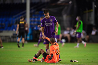 LAKE BUENA VISTA, FL - JULY 25: Joao Moutinho #4 of Orlando City SC and Clement Diop #23 of the Montreal Impact shake hands during a game between Montreal Impact and Orlando City SC at ESPN Wide World of Sports on July 25, 2020 in Lake Buena Vista, Florida.