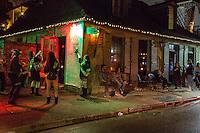 French Quarter, New Orleans, Louisiana.  Night Scene at Jean Lafitte's Blacksmith Shop Bar, Bourbon Street.  Built between 1722-32.