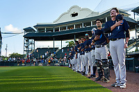 Tampa Tarpons, including pitcher Blane Abeyta (16) and catcher Antonio Gomez (5), during the national anthem before Game Two of the Low-A Southeast Championship Series against the Bradenton Marauders on September 22, 2021 at LECOM Park in Bradenton, Florida.  (Mike Janes/Four Seam Images)