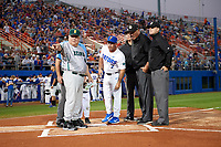 Siena Saints head coach Tony Rossi (40) and Florida Gators head coach Kevin O'Sullivan (7) go over the ground rules with home plate umpire Josh Miller (behind Rossi), and field umpires Chris Tipton (right), Hank Himmanen (center), Shane Livensparger (left) before a game on February 16, 2018 at Alfred A. McKethan Stadium in Gainesville, Florida.  Florida defeated Siena 7-1.  (Mike Janes/Four Seam Images)