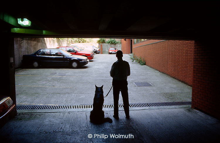 A Haringey council dog handler on patrol at a local authority garage.