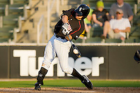 Nicholas Ciolli #20 of the Kannapolis Intimidators makes contact with the baseball at Fieldcrest Cannon Stadium April 25, 2010, in Kannapolis, North Carolina.  Photo by Brian Westerholt / Four Seam Images