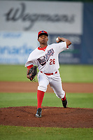 Auburn Doubledays relief pitcher Yonathan Ramirez (26) delivers a pitch during a game against the Connecticut Tigers on August 8, 2017 at Falcon Park in Auburn, New York.  Auburn defeated Connecticut 7-4.  (Mike Janes/Four Seam Images)